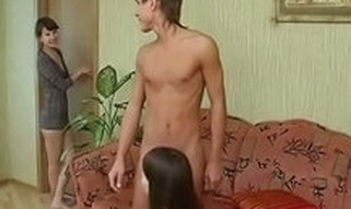 Pretty longhaired hotty is giving admirable oral sex to chap whilst second gal enters the room