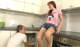 Fiery redhead enjoys being gangbanged in the kitchen