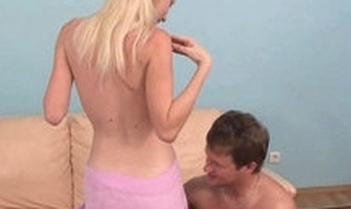 Stylish sporty lad-ally is taking off raiment of his golden-haired legal age teenager girlfriend previous to sex