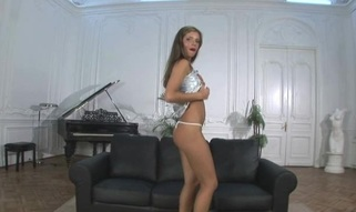 Enchanting angel stands in different positions during masturbation
