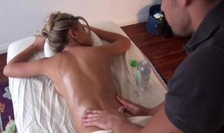 Massuer is having fun giving sexy playgirl a sensual massage