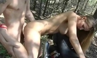 Guy and beauty are riding motorbike feeling meaty temptation to have wild pounding