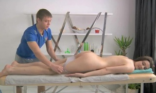 Juvenile masseur is getting a hard boner from massaging hottie
