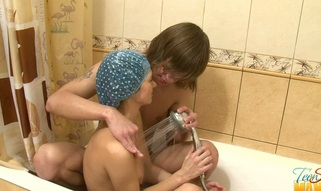 Teen in a shower cap is sucking meat