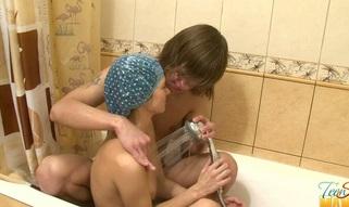 Teen in a shower cap is sucking meat
