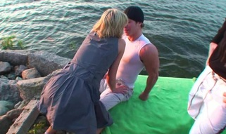 Blond goes to the water and is sandwiched