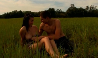 Wicked honey is delighting chap with oral-sex at the meadow