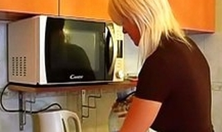 Blond honey is doing her businesses in the kitchen previous to getting holes nailed