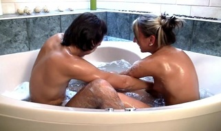 Sexually excited blond whore and her fuckmate make out in the bathtub