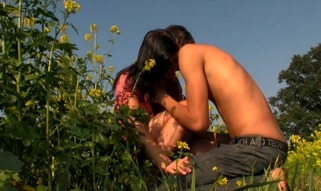 Brunette Hair exposes her sexy body and enjoys sex in flower field