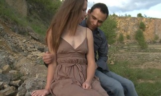 Legal Age Teenager wench copulates with her partner outdoors on a massive stone